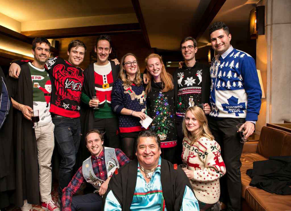 Junior Fellows in holiday sweaters