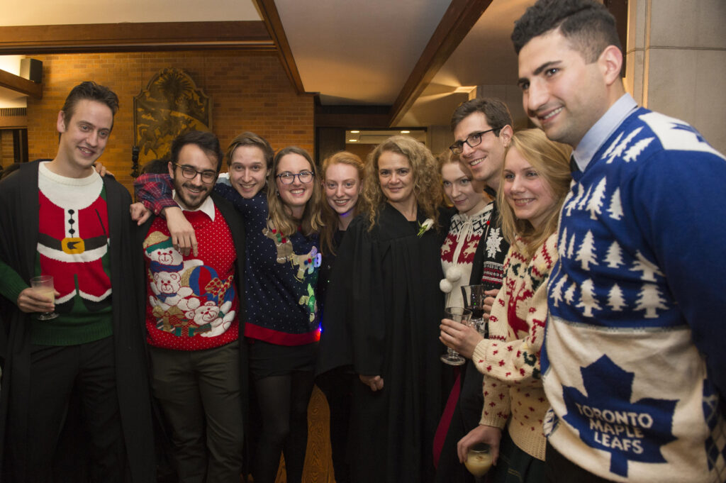 group wearing holiday sweaters