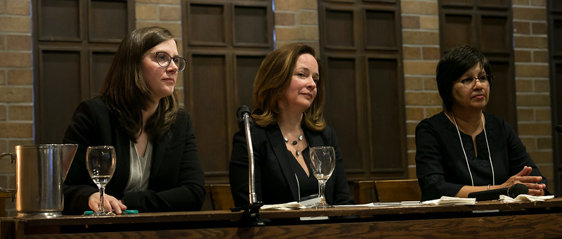 Women speaking on a panel