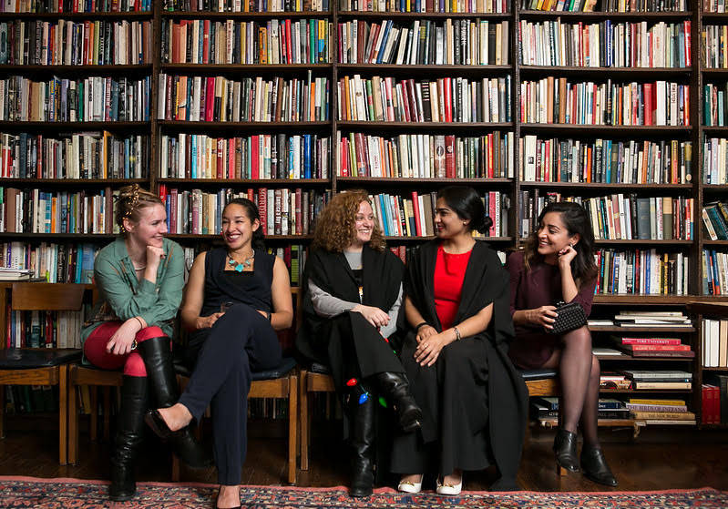 5 girls in a library